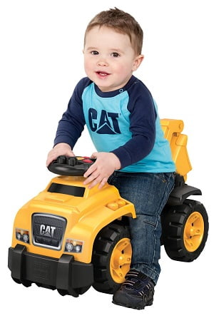 Little Boy Playing On A Mega Bloks Ride On Caterpillar Excavator Toy For Toddlers