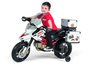 Little Boy Riding A Peg Perego Ducati Hypercross Ride On Toy Motorcycle