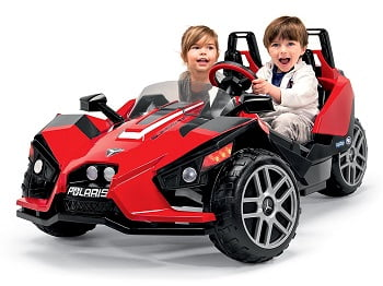 Two Kids Enjoying A Ride In Peg Perego Polaris Slingshot
