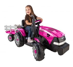 Little Girl Riding A Peg Perego Case IH Magnum Toy Tractor