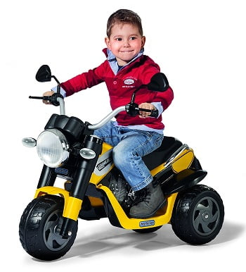 Little Boy Riding A Peg Perego Scrambler Ducati Ride On Motorcycle